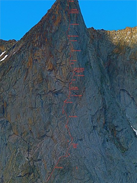 Detail topo of ITTIA pitches from the large ledge at the start to near the summit including pitches on Ambush Plaisir. Note that circles indicate belays while arrows are placed generally over or left of the line of ascent. Notes include pitch grades and brief descriptions. Larger arrows indicate rappel anchors.