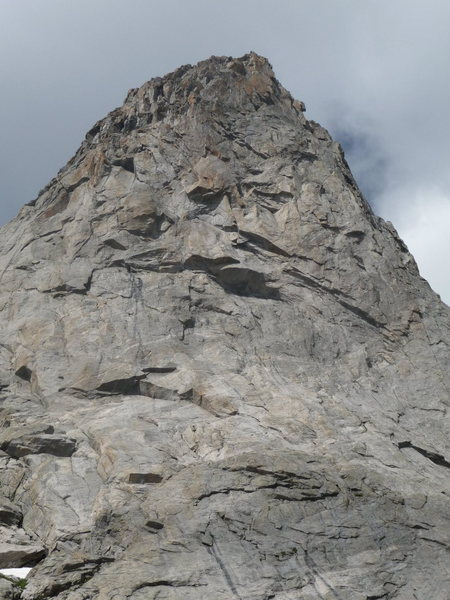 The formidable headwall of the east Face. ITTIA climbs slightly right (about 50-70 feet) of the very large roof at the base of the headwall