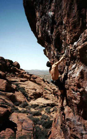 I'm free soloing A-cute Pain in 2nd pullout Red Rocks.  I wore sandals since the rock was too hot!
