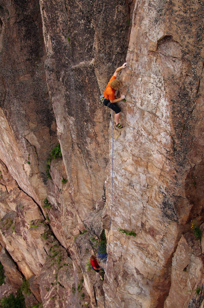 Bob Kryzer holding on to the arete on Swizzlestick Legs.