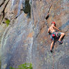 """Scott Arno moves with determination on the direct start (5.10b) to """"Rule of the Bone"""" (5.10c - Barkeater Cliff - Adirondacks, NY)"""