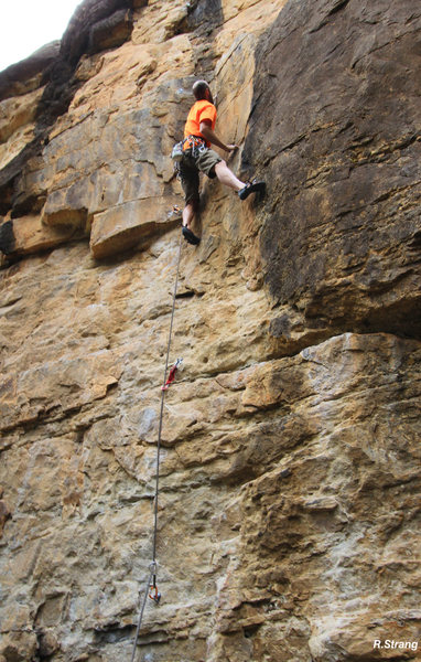 The LONG reach move up in the dihedral.<br> Cattle Drive (5.10+).