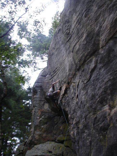 Rock Climbing Photo: Rhoads locking off on the crimp.
