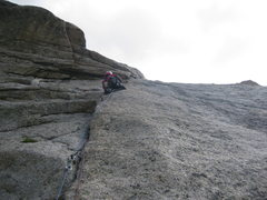 After finishing this section you end up on a huge ledge and have one more long pitch to the top.