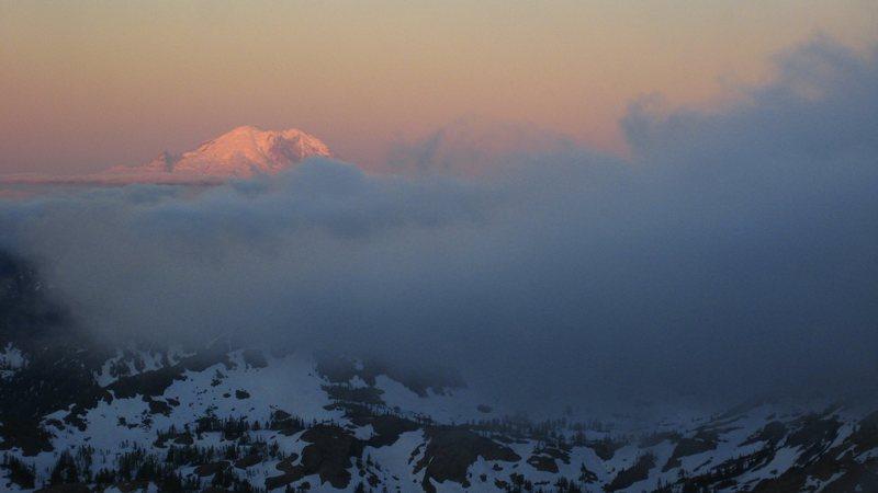 Rainier peaks out above the clouds while climbing Mt. Stuart