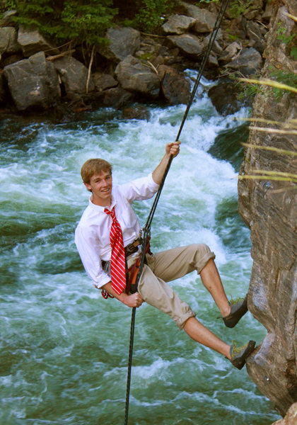 Senior photo while rappelling.  Interesting climbing this one in dress clothes.
