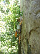 Rock Climbing Photo: Rhoads moving along on the crimps below the crack.