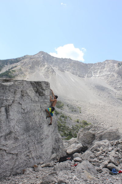 Mike B on the V0 Arete with Turtle Mountain in the background.<br> <br> Photo by Levi Ziegler