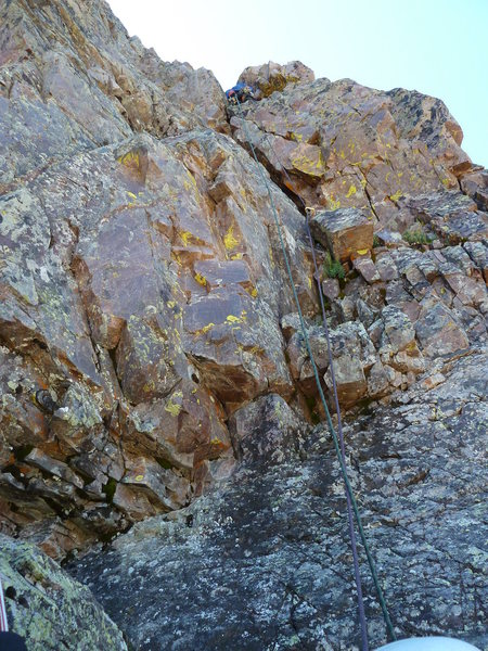Beginning of pitch four.  Loose blocks right above belay make this section harder than it should be.