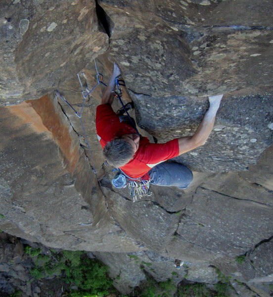 JJ turning the lip of the roof on the FA of Rusted Rapture 5.10, though it&@POUND@39@SEMICOLON@s super classic 5.9 at this point.  John Burcham with an attentive belay down low. Volunteer Canyon. <br> Wade Forrest Photo<br> <br>