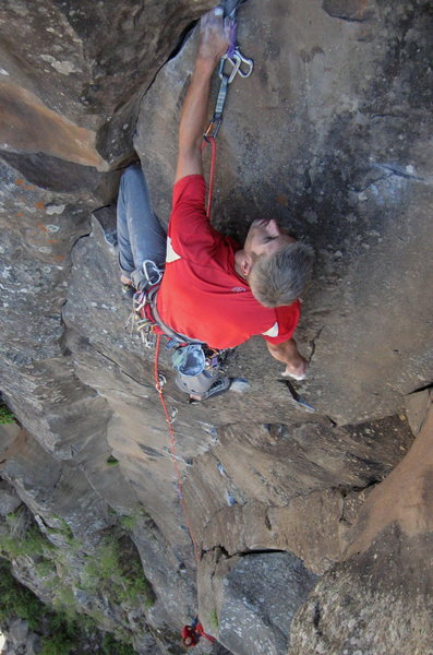 Rock Climbing Photo: Shaking out before the last boulder problem to the...