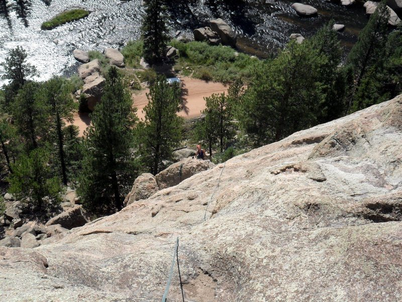 Looking down from the top of Arch Rock Direct to Brenda who is at the anchors at the top of the Middle Dihedral.