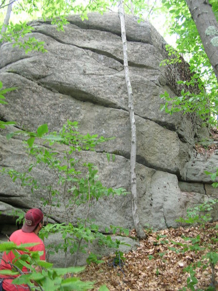 "The blunt arete of ""Shaman Moves"" is just right of the tree.  Begin and end left of the line of the arete, but cross right twice en route.  Joshua Corbett scopes out the route after the FA."