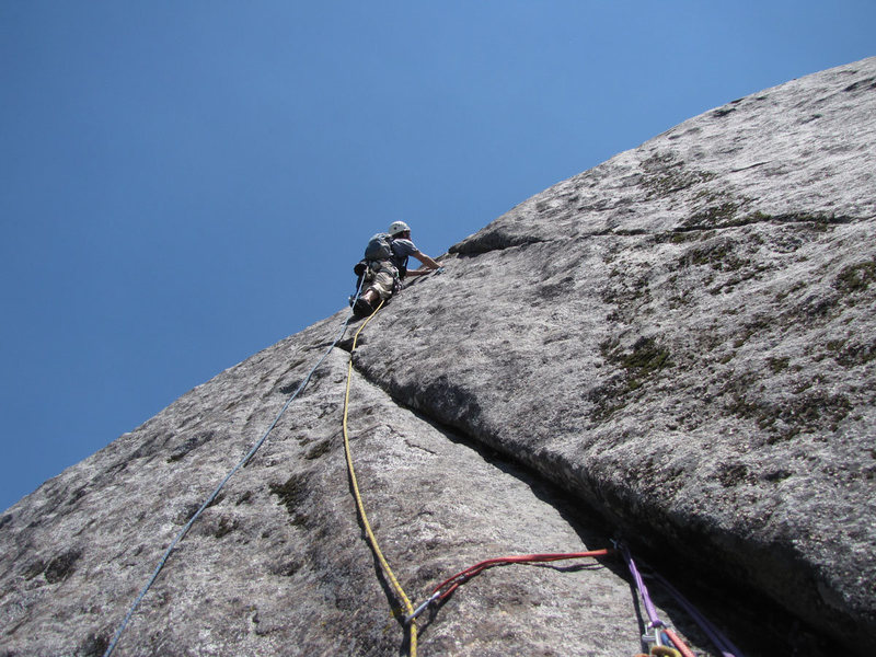Leaving the belay on pitch three.