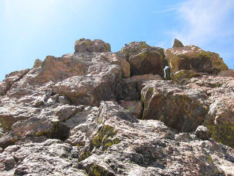 The first half of the final pitch of the so-called 3rd Class Standard Route of Hayden Spire. Though it doesn't look like hard climbing, the vertical, roofy section goes up about 70-80 ft. before leveling off left toward the summit.