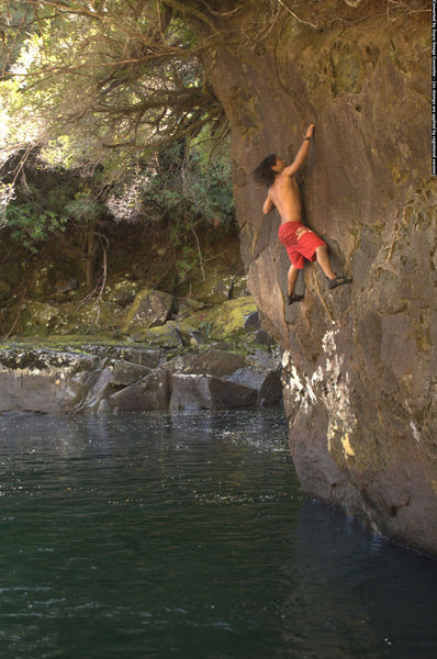 Deep-water bouldering over the Cochamó River in the Cochamó Valley.