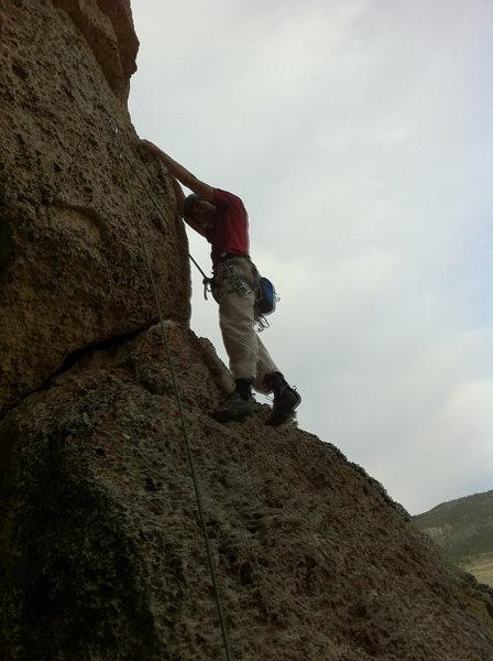 Climber at the first bolt.