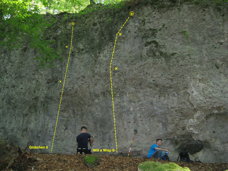 The climbs furthest to the right on the left side (passing the cave and keep walking.