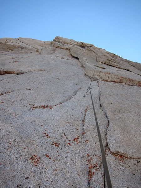 Looking up at the crux 3rd pitch. You can see both the crux seam and the thin dihedral.