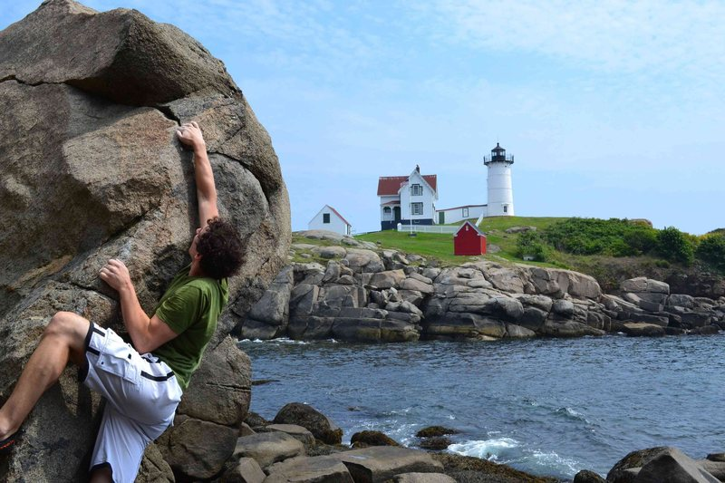 Tyler climbing at Nubble Lighthouse.  The scenery might be better than the rock.