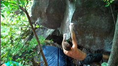 Rock Climbing Photo: Peter eyes the ninja kick move.