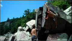 Rock Climbing Photo: The committing crux, a knee scum and a long reach.