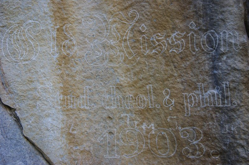 The engraving at the base of Theology Crag