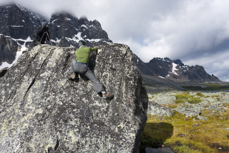 Bouldering in Tonquin Valley, Ramparts in the background.