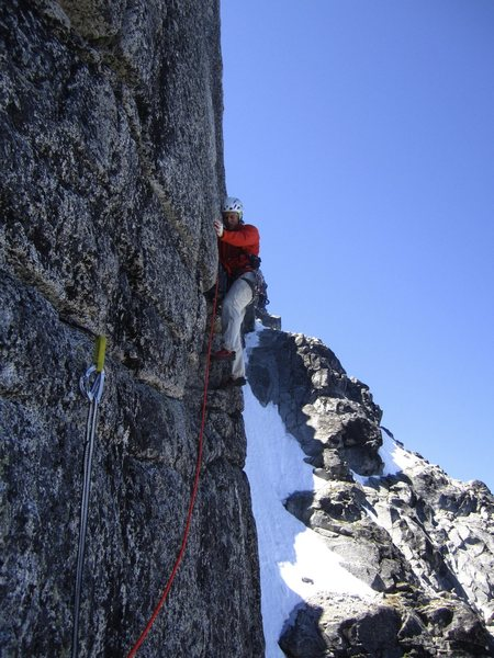 Beginning the wide crack crux on the gendarme.  Photo by Brad J.