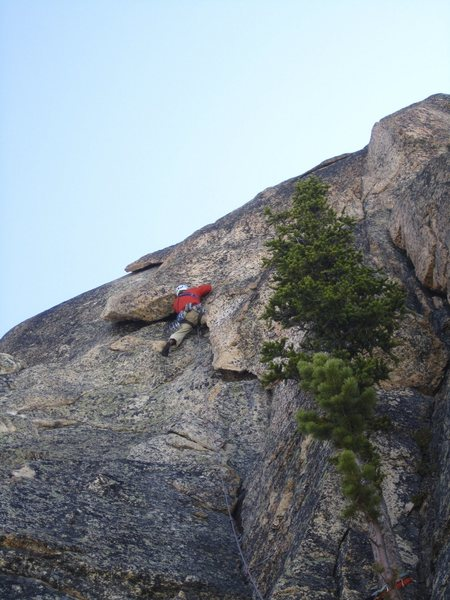 Climbing the 5.8 wide layback pitch.  Photo by Brad J.