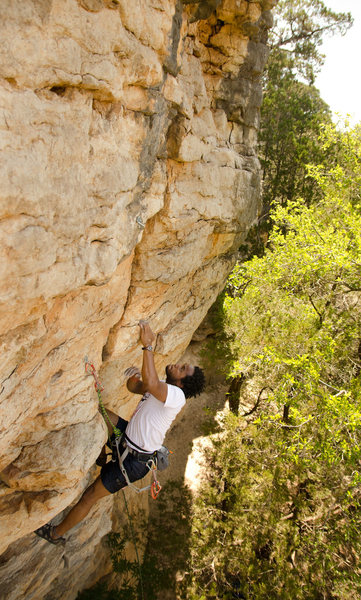 Mario Stanley making the crux move on Brazos Bros.