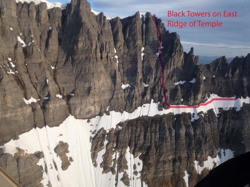 from Brian Webster (Canadian Mountain Guide): When<br> traversing left on the large snow slope (after topping out on the Big Step)<br> you will encounter an obvious rock pinnacle that originates from the snow<br> slope and is about 10 metres high. (If you are traversing the snow slope<br> near the top, close to the moat, you would bump into this pinnacle.) The<br> exit gully is just on the other side of the pinnacle, but  most climbers<br> scramble up between the pinnacle and the main wall (you can create a belay<br> by slinging the top of the pinnacle). From here climb loose rock up and<br> left so as to merge into the exit gully higher up. It is about 5 pitches of<br> loose 5.4ish rock and/or snow and ice climbing to reach the summit ridge.