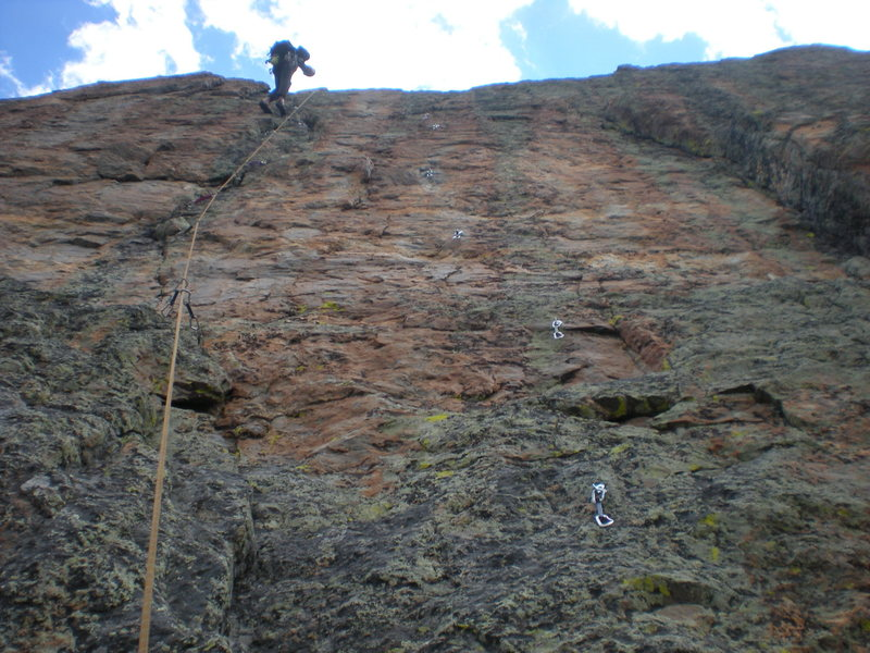 Pitch 3 of 'Brass Junkie'. Paul lowering back to the '5.10 ledge' belay after the First Ascent. ('The Hotness' follows the line of bolts to the right.)