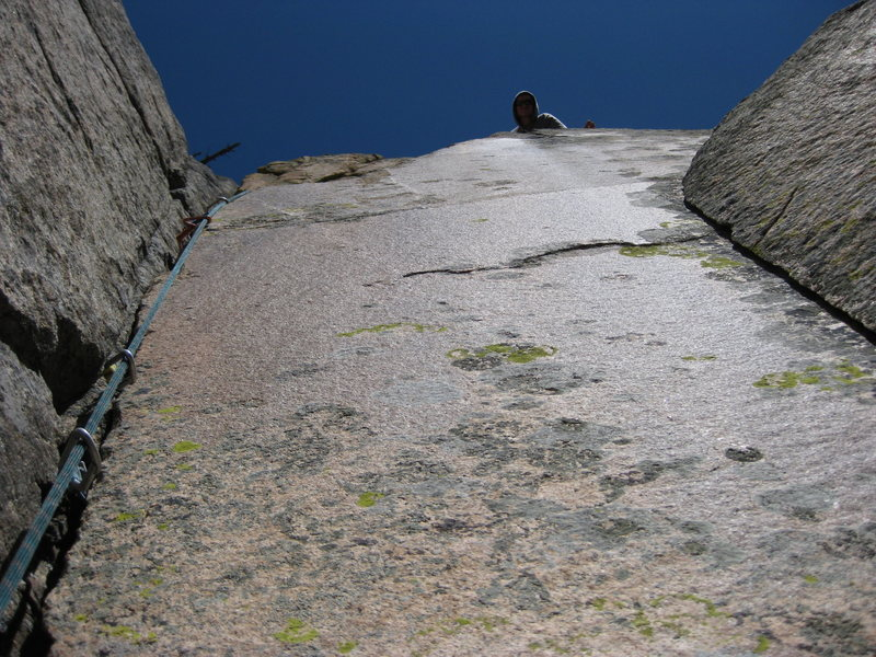 Jake looking up at me on the first ascent of P1.