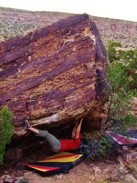 Brad working the Multiverse Boulder overhang, this is the east face lip that is negotiated for the Serious Black problem.