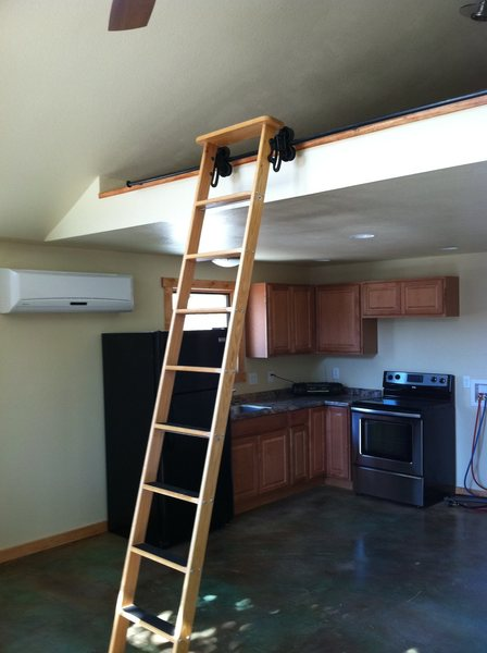Library ladder leads to loft.