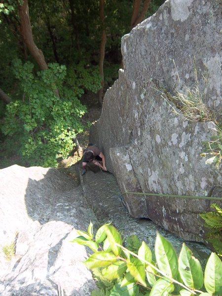 Ben Botelho follows the right side of Pillar(5.7), Poke-O Moonshine, Adirondacks, NY