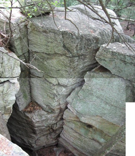 View of the pit's south wall (which faces north...let's call it the front side).  Arete-in-a-Hole on the left, Wide Crack on the right.