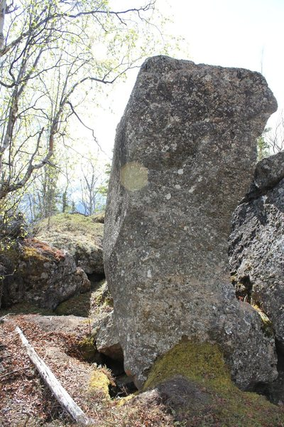 """Tombstone Boulder. Around back and right of """"sweet tooth"""" is a grey tombstone like block about 10-11' high, 3' thick, and 8' wide. Poser is the face in the picture."""