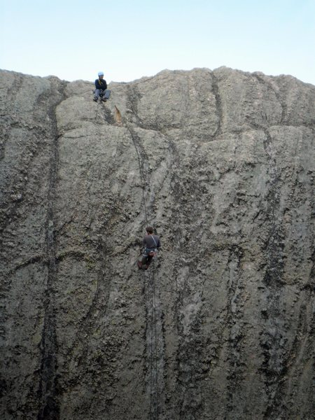Rappeling down the Sylvan Lake side of the Outer Outlet, across from the Inner Outlet's Classic Crack