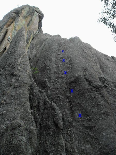Bolts on Katey's Route shown in blue.  It's run out above the last bolt to the anchor, but it's very easy low-class five climbing about 10 feet above the top bolt.  A climber is simul-rapping off of Lander's Turkey Shoot on the top left of the photo while the other climber is simul-rapping down the other side of the fin.