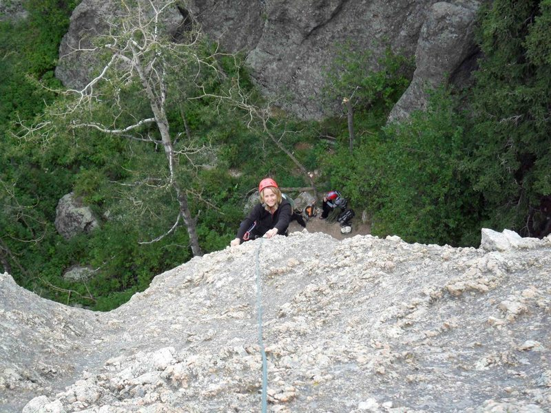 Brenda finishes up top of Katey's Route -- easy, well-featured climbing on the run out portion.