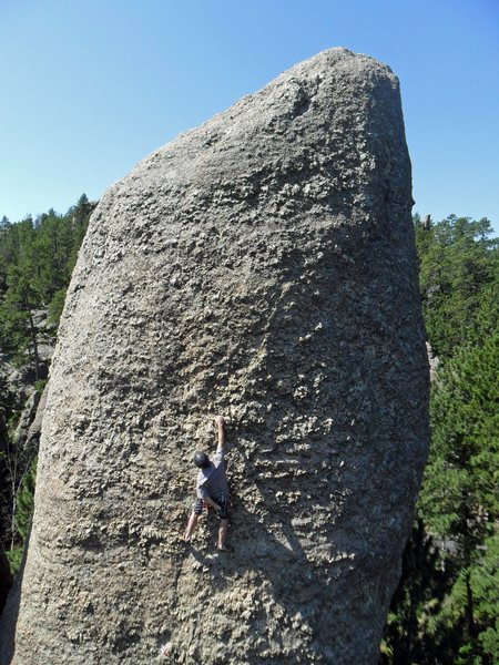 """Climber on the East Face of the Queen Pin on Sept 3, 2011 -- I think this route is called """"Dairy Queen.""""  Photo taken from the summit of the Tricouni Nail."""