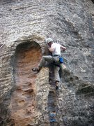 Rock Climbing Photo: Clipping the second to last bolt at the upper scoo...