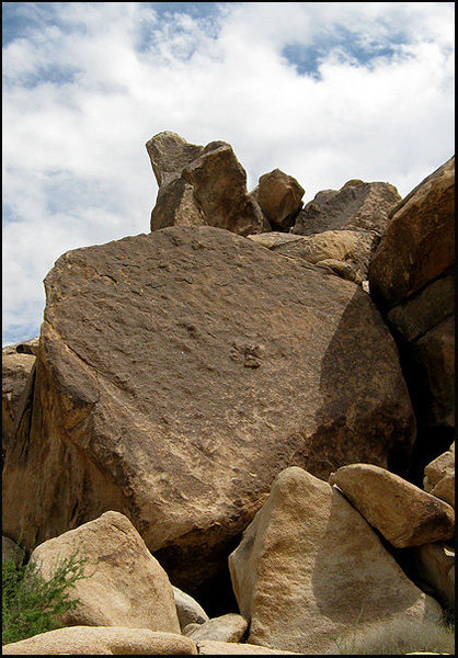 &quot;Candyass&quot; goes up just left of the center of the boulder.<br> Photo by Blitzo.