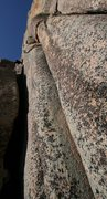 Rock Climbing Photo: SPLITTER crack on the left with a climber exiting ...