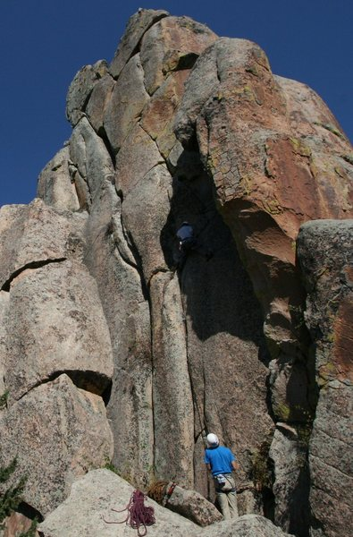 Matt Coffman on the second ascent milking one of the few rest stances before the second crux.