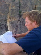 Rock Climbing Photo: Hunter reading the journal left at the top in an a...