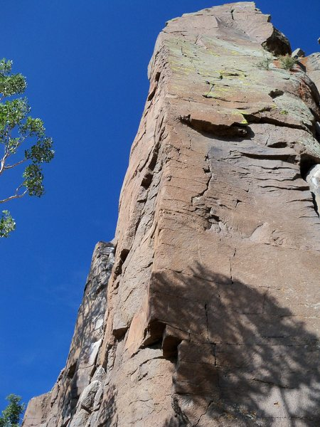 As route traverses right around the arete to this north side, climbing progressively gets dicier