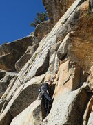 Rock Climbing Photo: M. Carnes hand drilling the bolt on the ground up ...